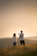 couple pointing to a beautiful landscape