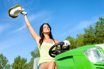 Happy gardener working with garden tractor