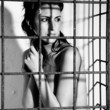 woman locked in a cage