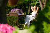 Woman resting in garden on summer