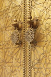 The golden door knockers of the Royal Palace in Fes, Morocco