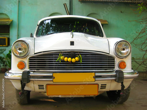 Indian white car Ambassador - VIP taxi service