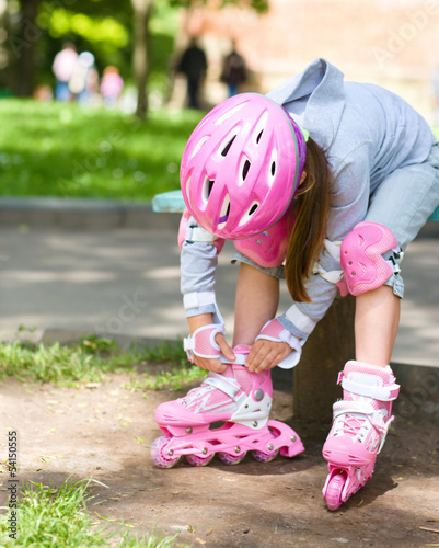 Little girl is wearing roller-blades