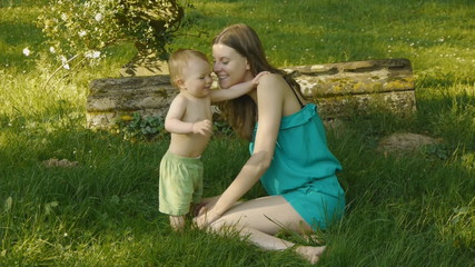 HD1080p25 Young mother with baby playing in the garden.