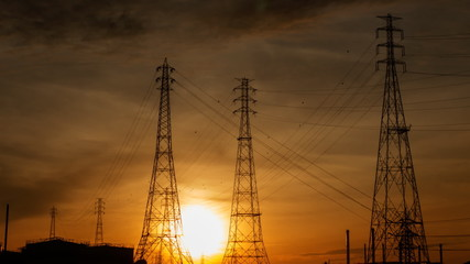 Electric pylons with time lapse sunrise