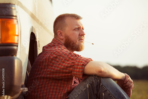 Red-bearded man on a summer evening