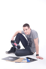 Young man sitting on the floor and review vinyl records