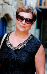 Portrait of elegance 60-years-old beautiful woman outdoors