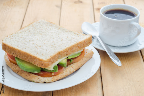 Breakfast; avocado sandwich with black coffee