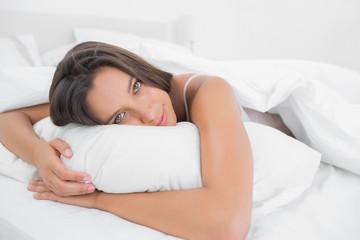 Awake woman relaxing in bed