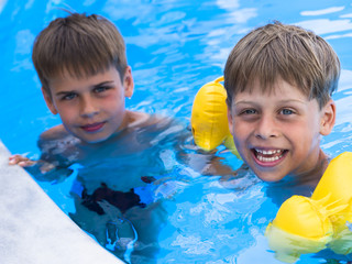 happy brothers in the swimming pool