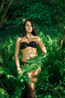 girl dressed in a black  bikini