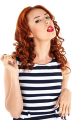 Red-haired girl shows tongue