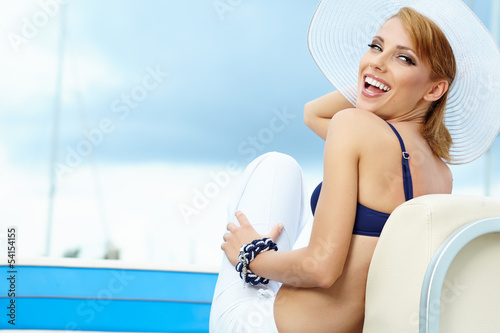 Outdoor portrait of a beautiful summer woman in hat