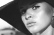 close-up portrait of beautiful woman in hat