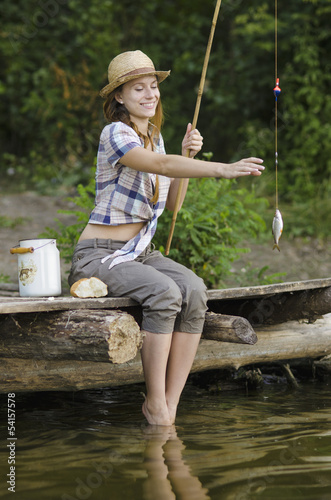 Young woman catches a fish
