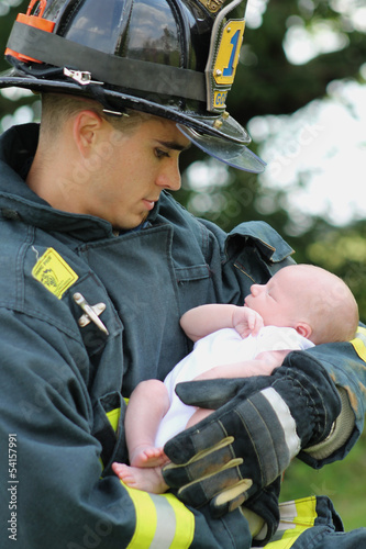 Firefighter Holding Baby