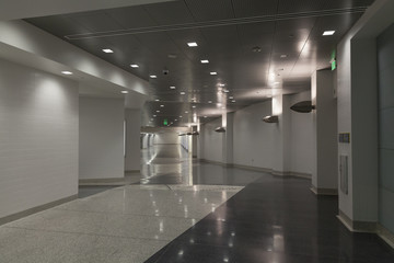 A unique, empty hallway with minimal color.