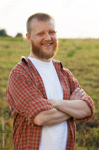 Happy red-bearded man in a shirt