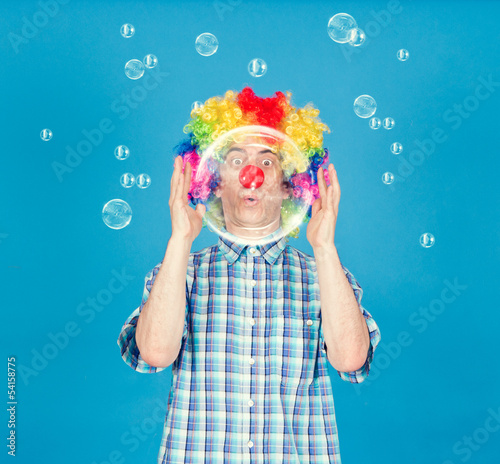Funny clown with soap bubbles.