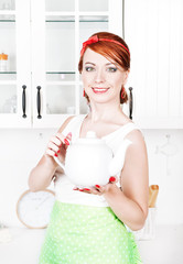 Stylish beautiful housewife with teapot
