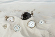 Pocket watches in the sand