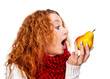Redheaded girl wants to eat a pear