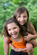 Two little Girls having Fun in Nature