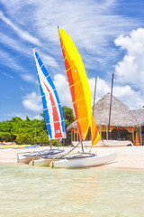 Colorful catamarans at a resort on a beach in Cuba