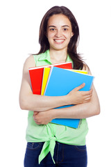 Young happy female student carrying books, isolated on white bac
