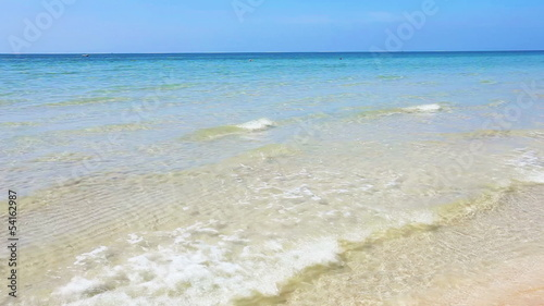 Beautiful tropical beach with sea view, clean water & blue sky.