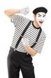Male mime artist gesturing
