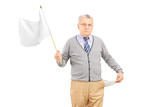Sad senior man waving a white flag and showing his empty pocket