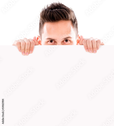 Man hiding behind banner