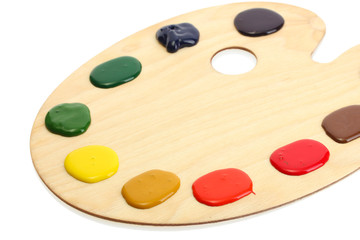 wooden art palette with paint isolated on white