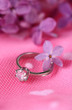 Beautiful wedding ring on pink background