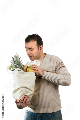 Man Looking Inside His Grocery Bag