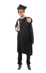 Asian male university student in graduation gown thumb up