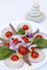 Sardine fillets on a white ceramic plate