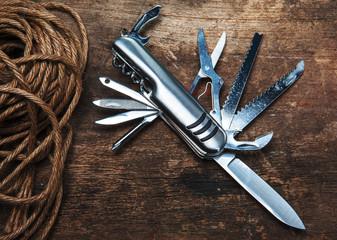 multipurpose pocket knife on wood