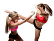Two attractive athletic girls fighting over white background