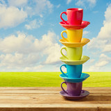 Rainbow color cups on wooden table