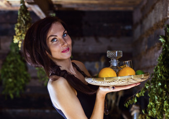 young beautiful woman with tequila and citrus