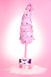 Christmas tree with curved tip on pink background