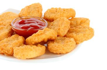 Fried chicken nuggets and sauce isolated on white