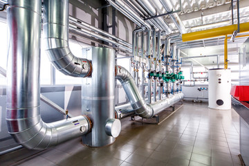 interior of an industrial boiler, the piping, pumps and motors