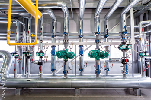 Staande foto Industrial geb. interior of an industrial boiler, the piping, pumps and motors