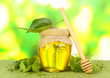 Jar of honey with flowers of lime,
