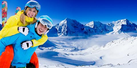 Skiing, winter sports - couple having fun on ski