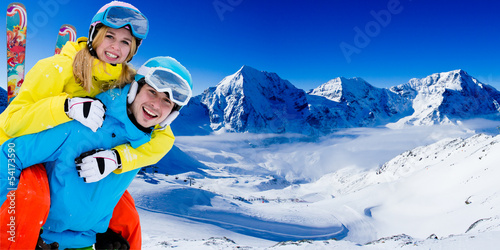 Skiing, winter sports - couple having fun on ski